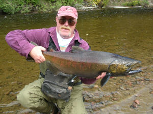 Jeff Novak shows off a 15 lb male Pinook Salmon caught on the Garden River